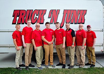 Truck N Junk employees in front of truck