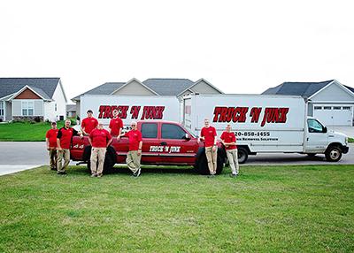 Truck 'N Junk's junk removal trucks and team