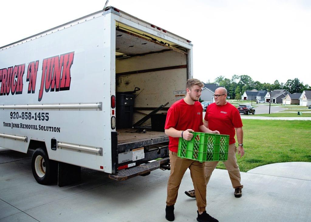 Truck 'N Junk employees working